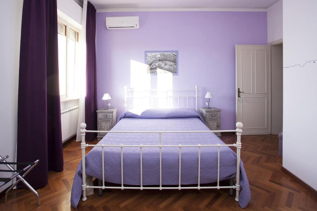 Cama ou camas em um quarto em B&B Cento Passi Dalle Mura