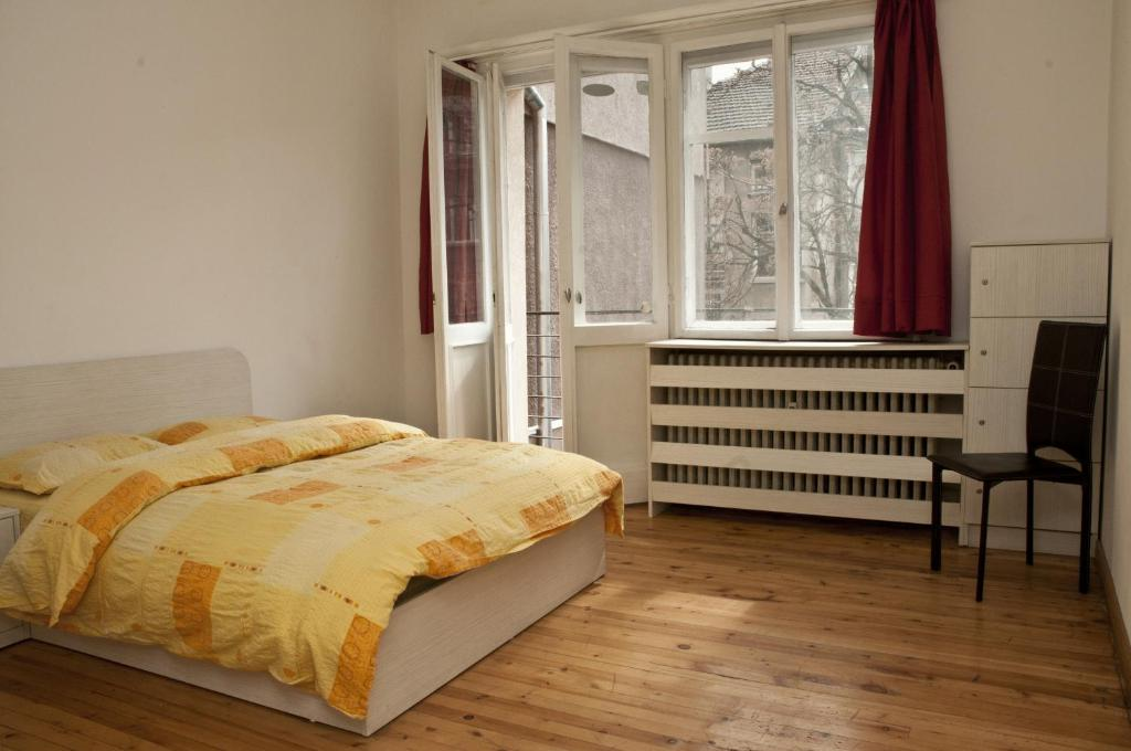 A bed or beds in a room at Hostel Mostel Sofia