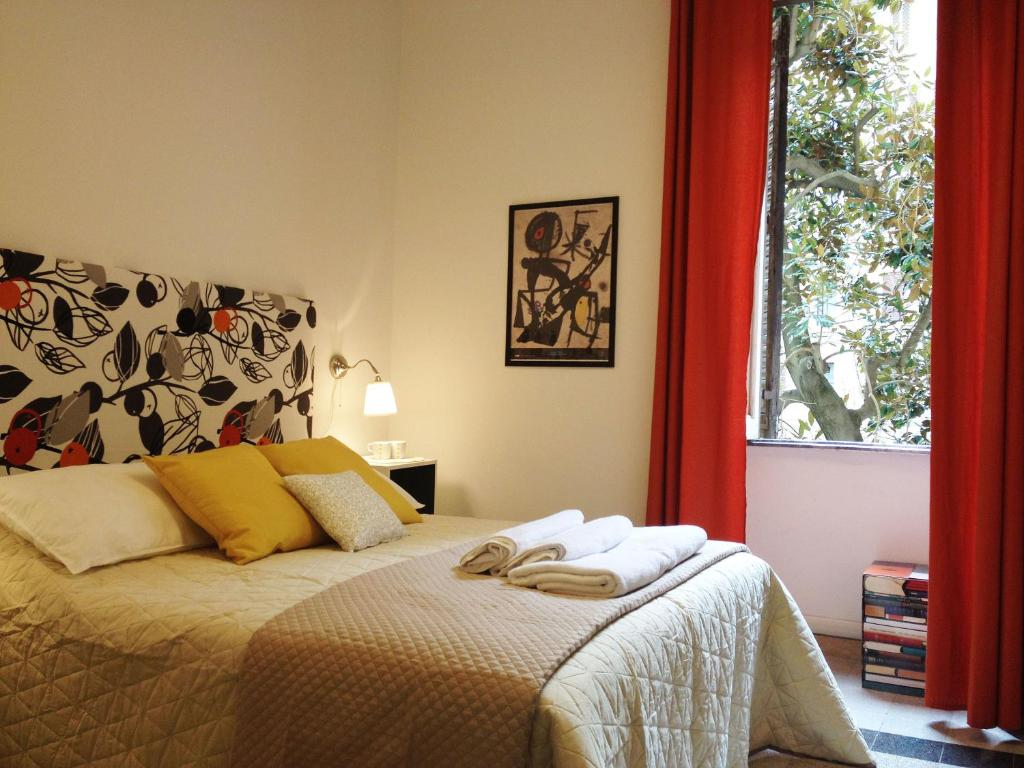 Ein Bett oder Betten in einem Zimmer der Unterkunft Domò Vaticano Guest House