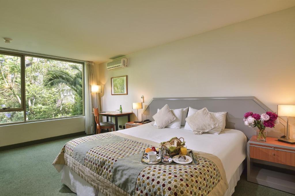 Cama o camas de una habitación en Hotel Eurotel El Bosque