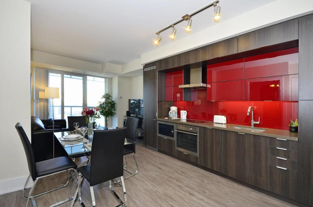A kitchen or kitchenette at Atlas Suites - CN Tower & Convention Centre Toronto