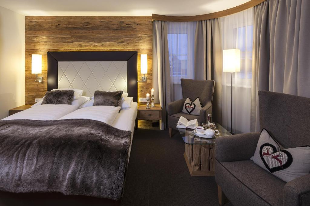 A bed or beds in a room at Superior Hotel Panorama