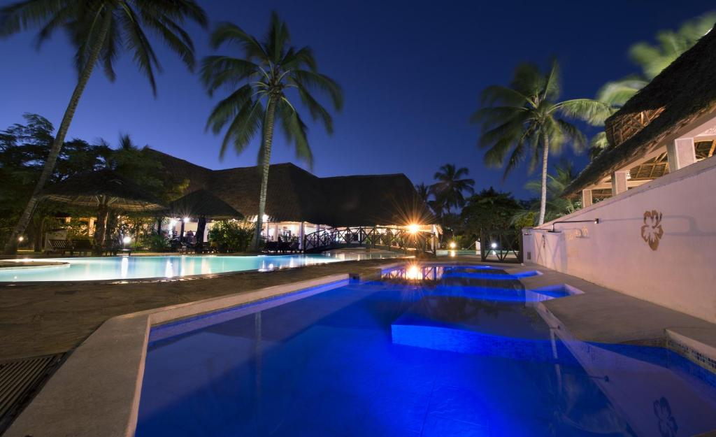 The swimming pool at or near Uroa Bay Beach Resort