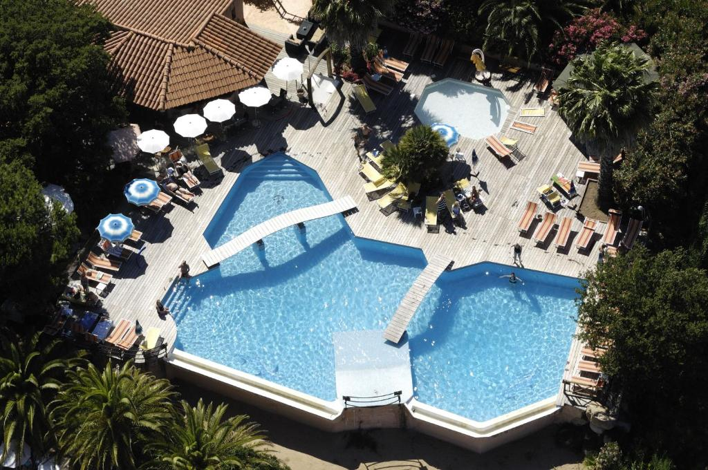 A view of the pool at Hotel Club U Libecciu or nearby