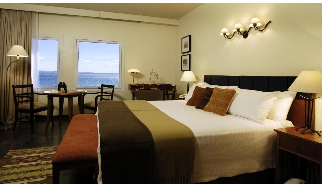 A bed or beds in a room at Hotel Territorio