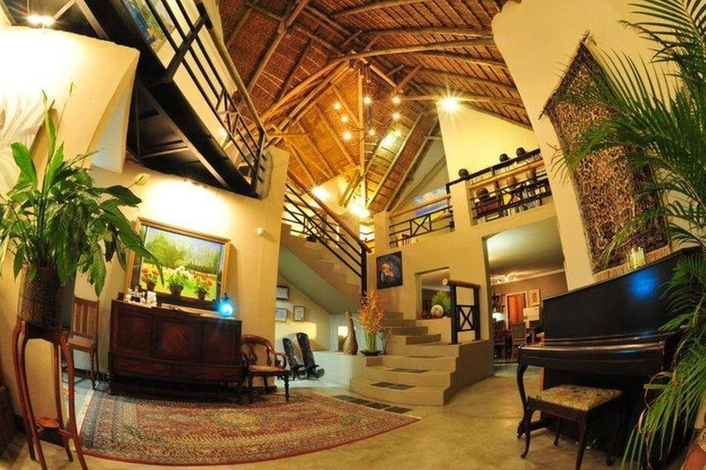 The lobby or reception area at Utopia in Africa Guest Villa