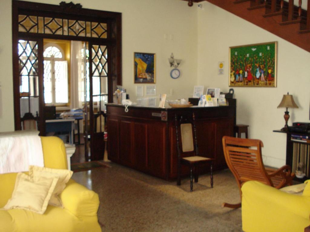 The lobby or reception area at Pousada Manga Rosa