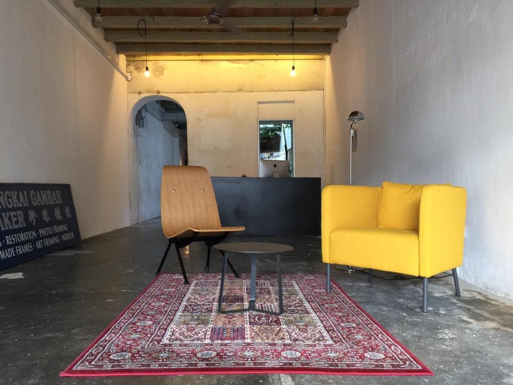 Ein Sitzbereich in der Unterkunft The Frame Guesthouse