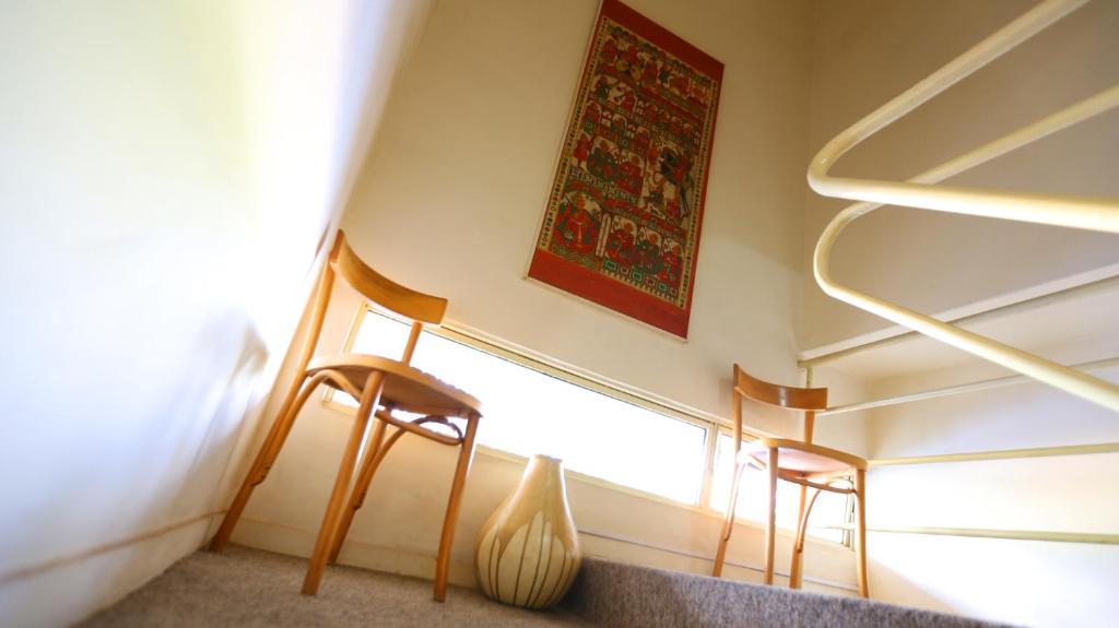 מיטה או מיטות קומותיים בחדר ב-Mansoori Apart Hotel I