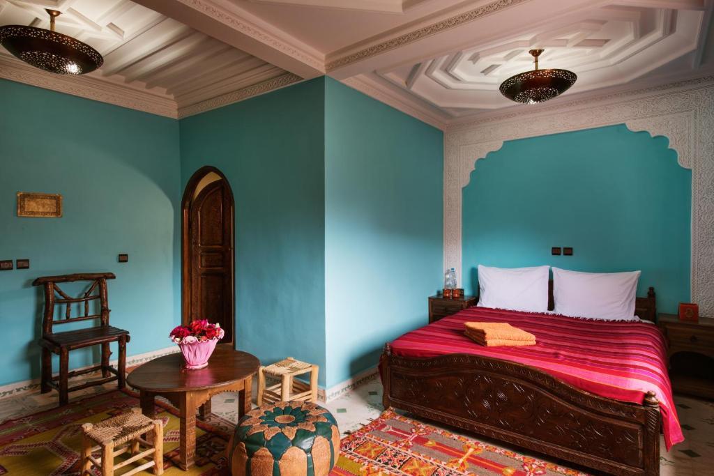 Uma cama ou camas num quarto em Imlil Lodge