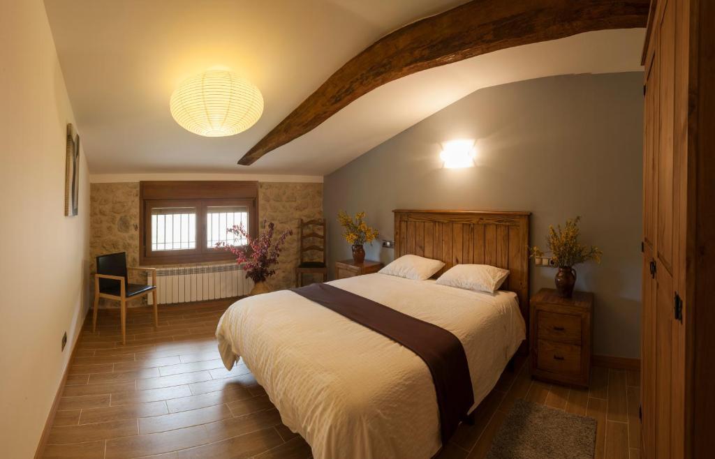 A bed or beds in a room at Casa Rural Aranaratxe