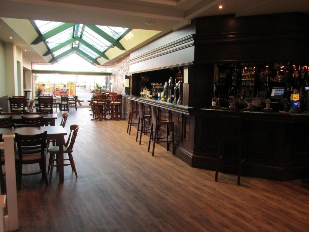 The lounge or bar area at The Harboro Hotel