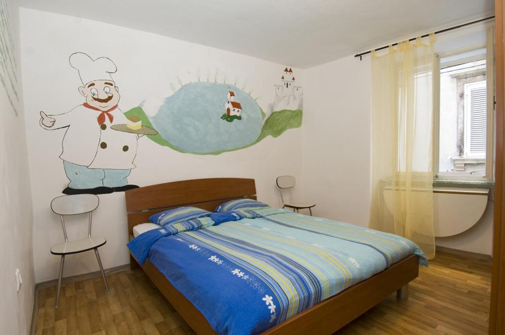 Postelja oz. postelje v sobi nastanitve Alibi B11