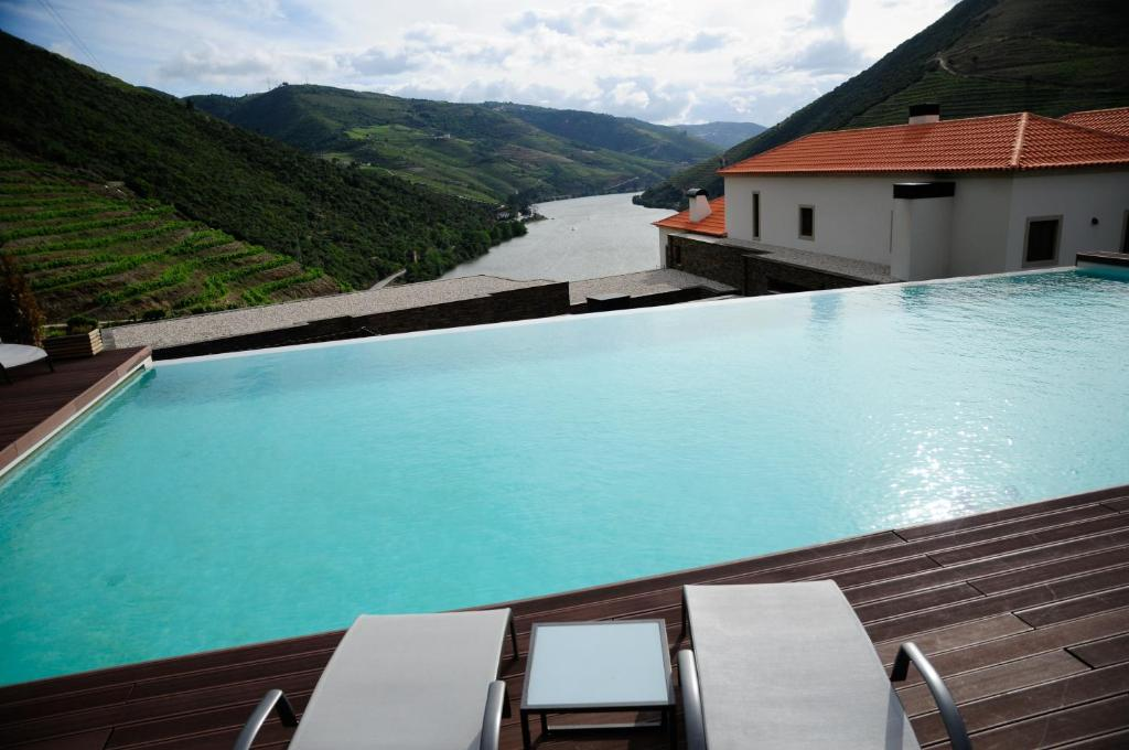 The swimming pool at or near Hotel Rural Quinta Do Pego