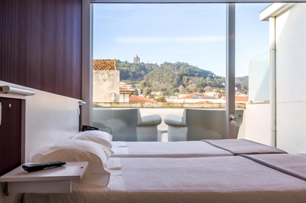 Uma cama ou camas num quarto em Hotel Laranjeira