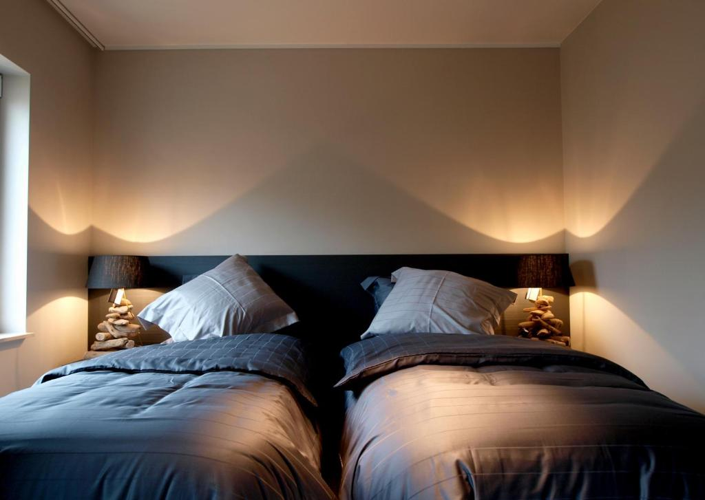 A bed or beds in a room at Private House