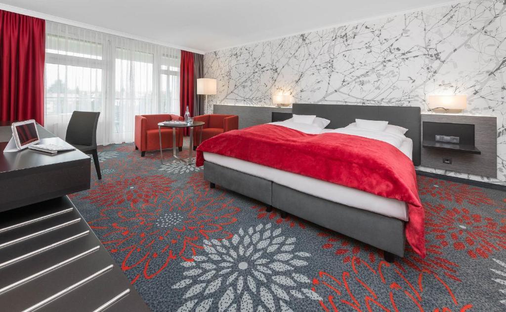 Ein Bett oder Betten in einem Zimmer der Unterkunft SI-SUITES