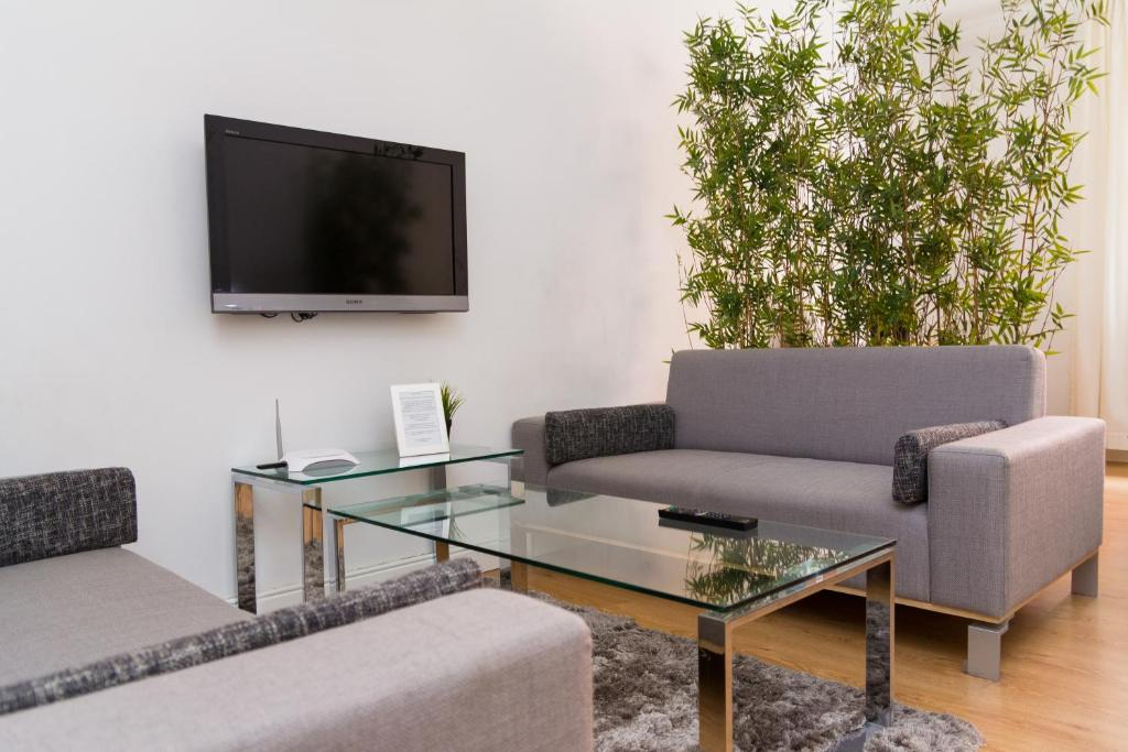 Telewizja i/lub zestaw kina domowego w obiekcie Modern Apartments