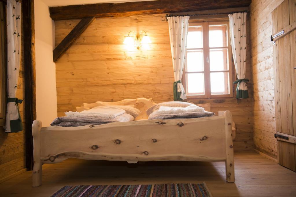 A bed or beds in a room at Baumgartner - Bauernhaus
