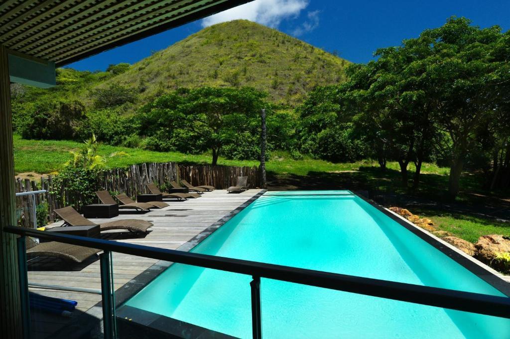 The swimming pool at or near Betikure Parc Lodge