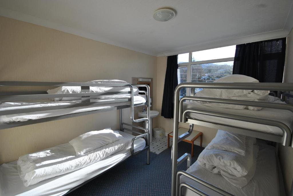 A bunk bed or bunk beds in a room at Saucy Mary's Lodge