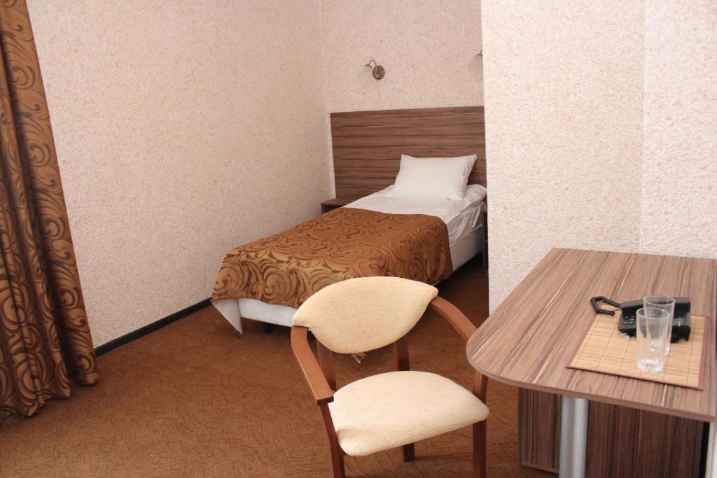 Кровать или кровати в номере Отель Кубань