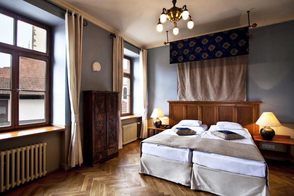 Postel nebo postele na pokoji v ubytování Hotel Nautilus