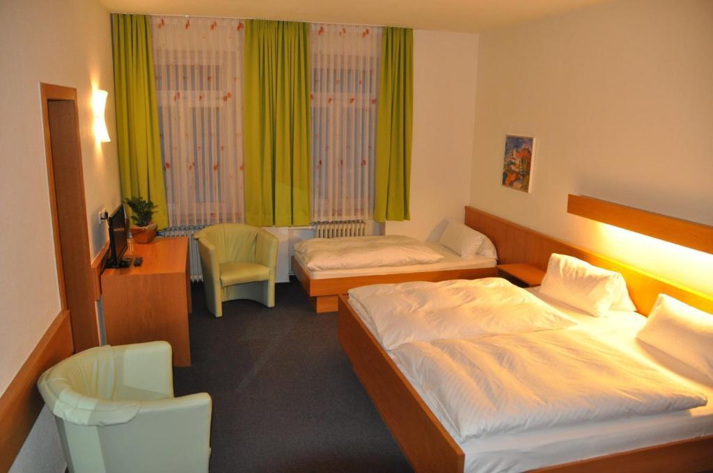 Ein Bett oder Betten in einem Zimmer der Unterkunft Hotel Lamm