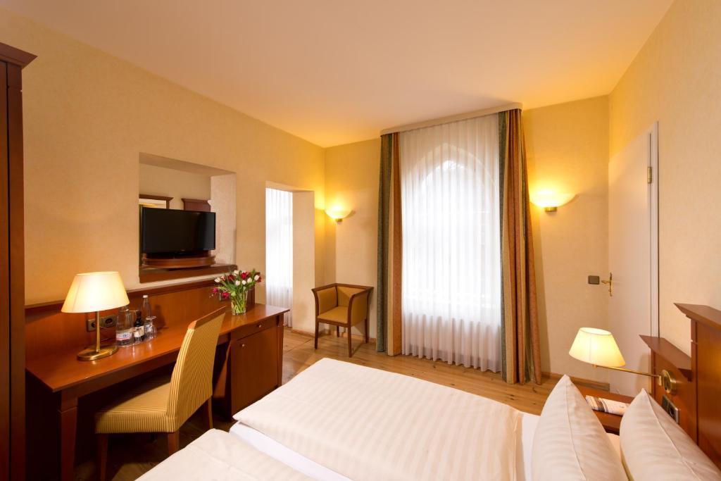 Телевизор и/или развлекательный центр в Hotel Augustinenhof