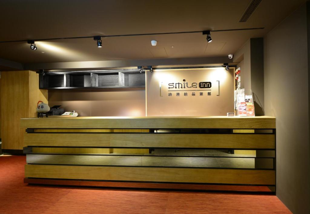The lobby or reception area at Smile Inn - Taipei Main Station