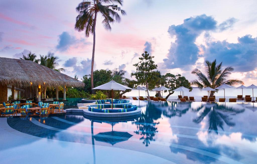 The swimming pool at or close to Six Senses Laamu