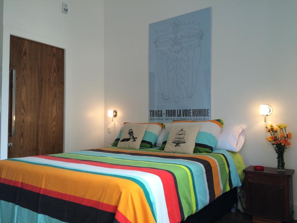 Cama ou camas em um quarto em Studio Rio Beira Mar