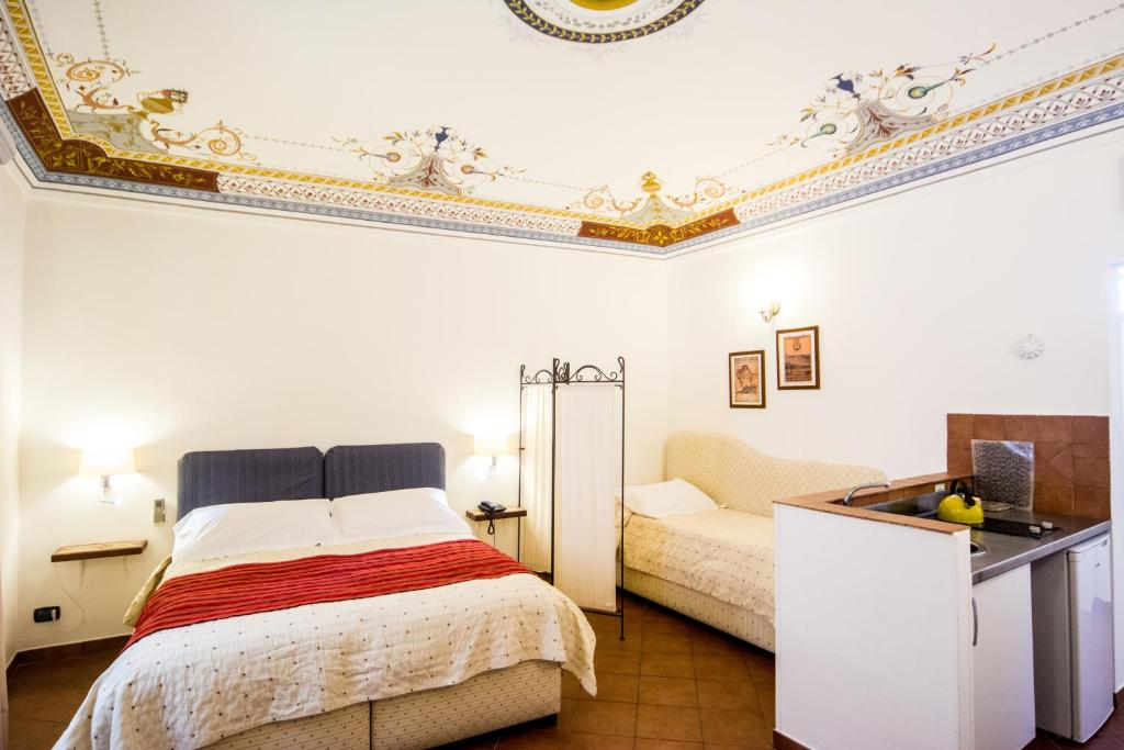 A bed or beds in a room at Aretusa Vacanze B&B