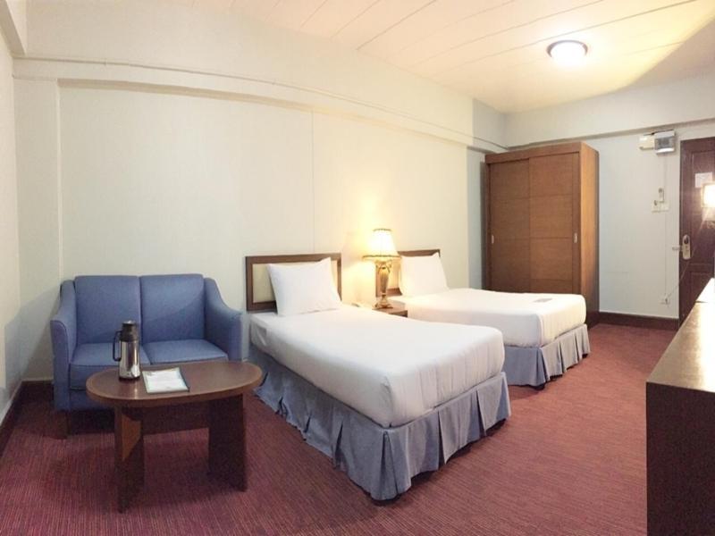 Кровать или кровати в номере The Canal Hotel