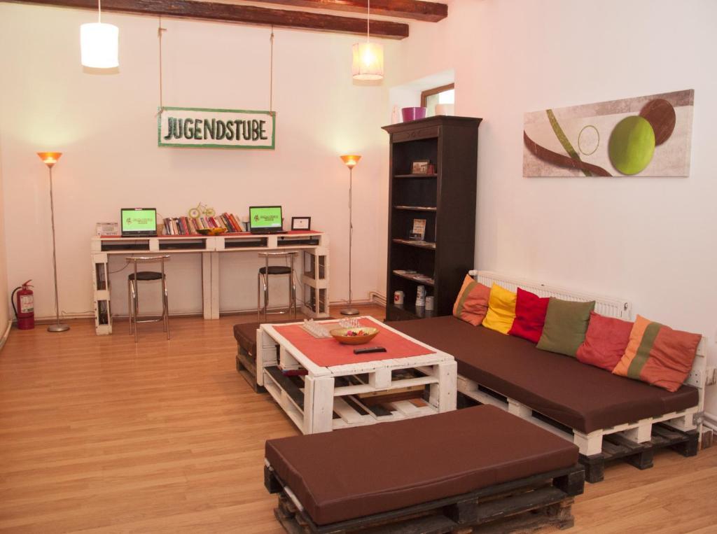 A seating area at JugendStube Hostel