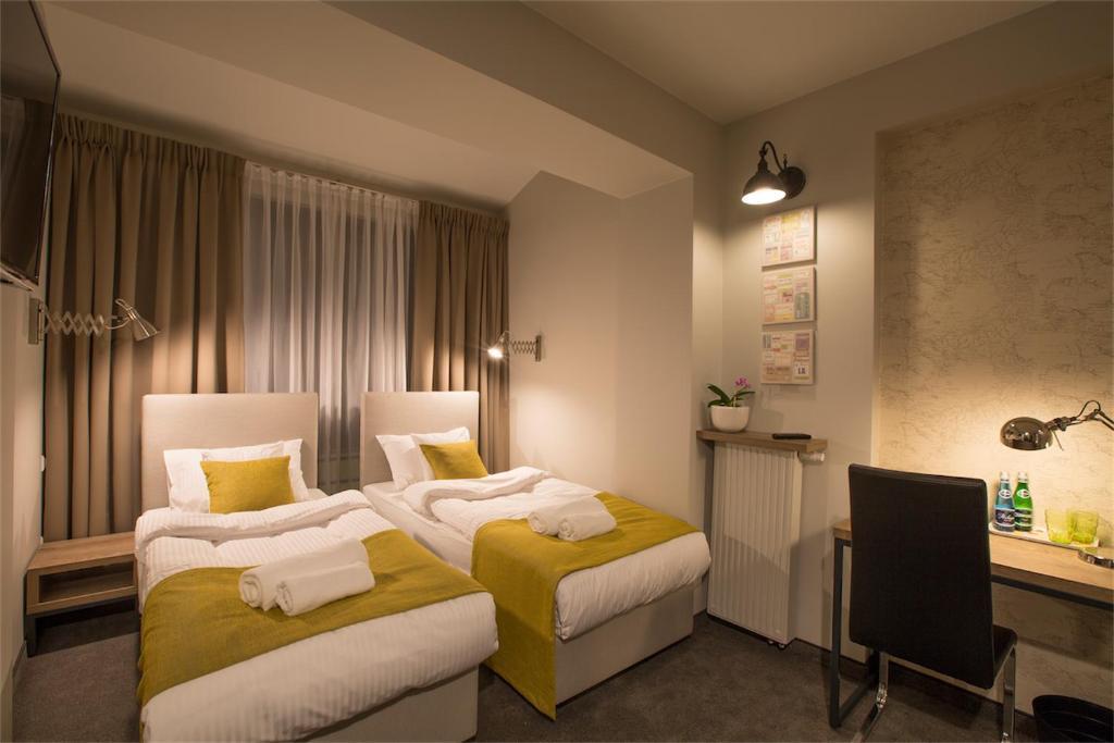 Łóżko lub łóżka w pokoju w obiekcie MarcoPolo House