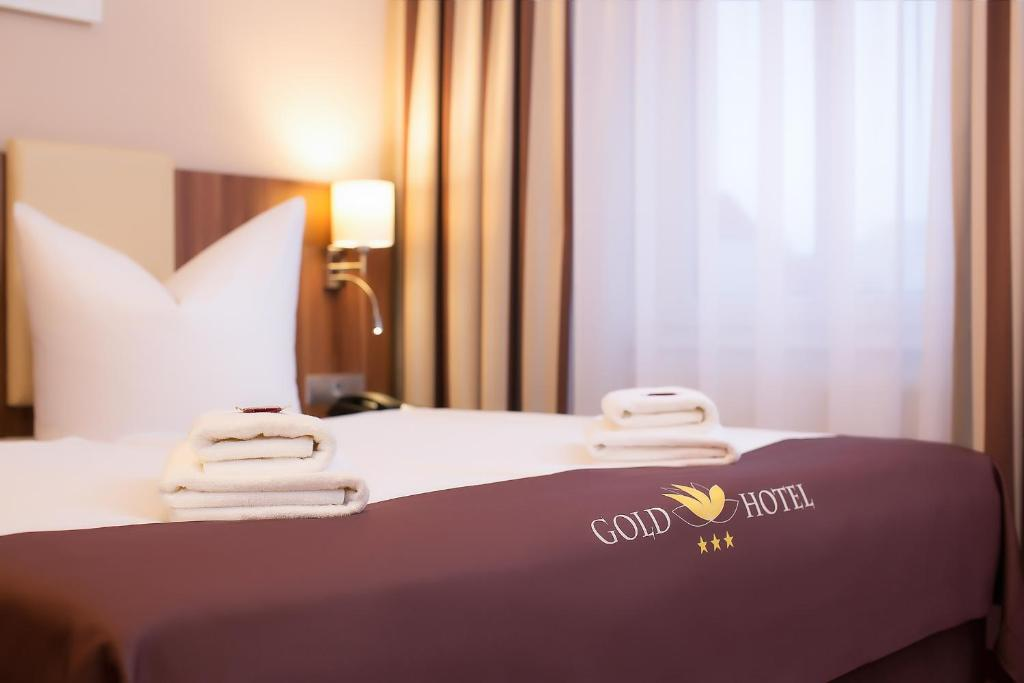 Un ou plusieurs lits dans un hébergement de l'établissement Gold Hotel
