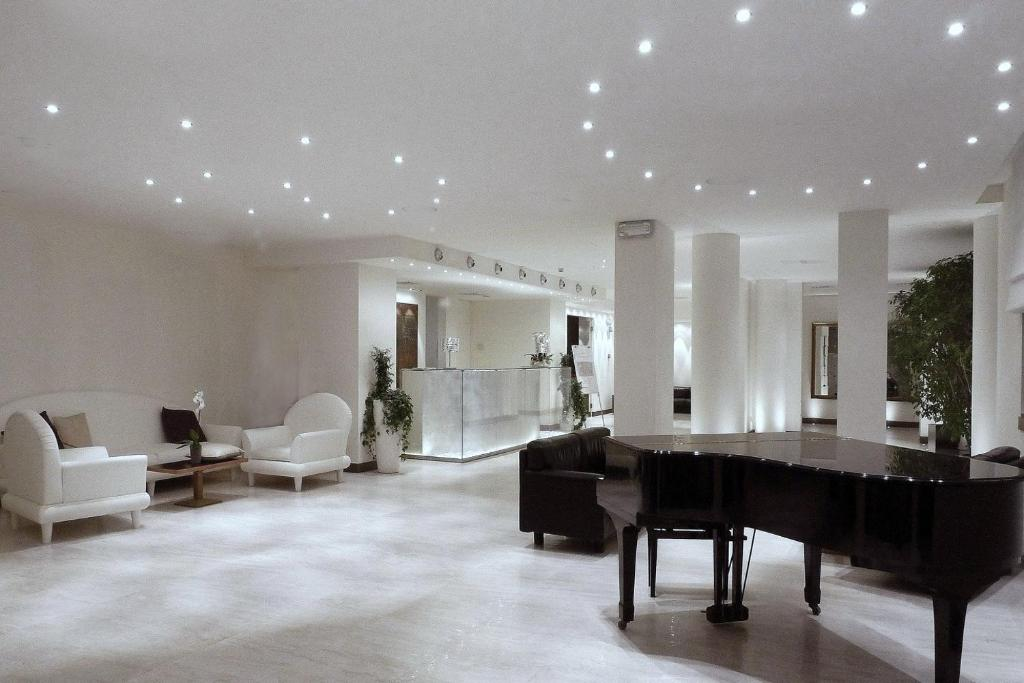 The lobby or reception area at Hotel Lugano
