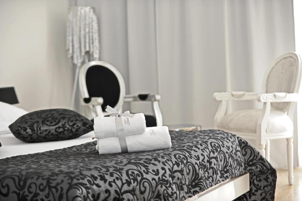 Cama ou camas em um quarto em Tinel Superior Residence