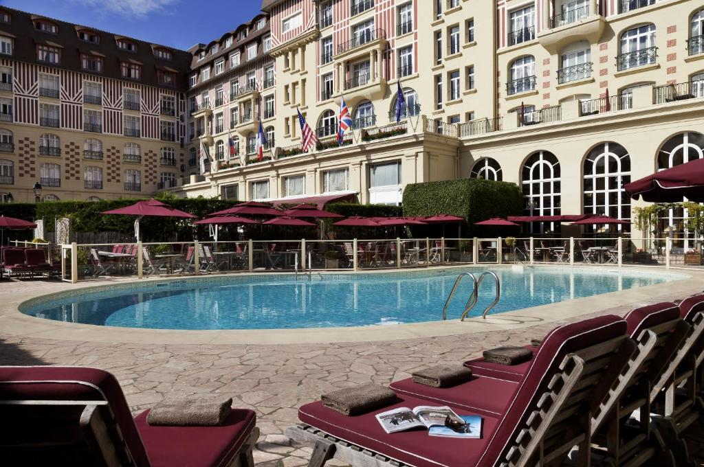 The swimming pool at or near Hôtel Barrière Le Royal Deauville
