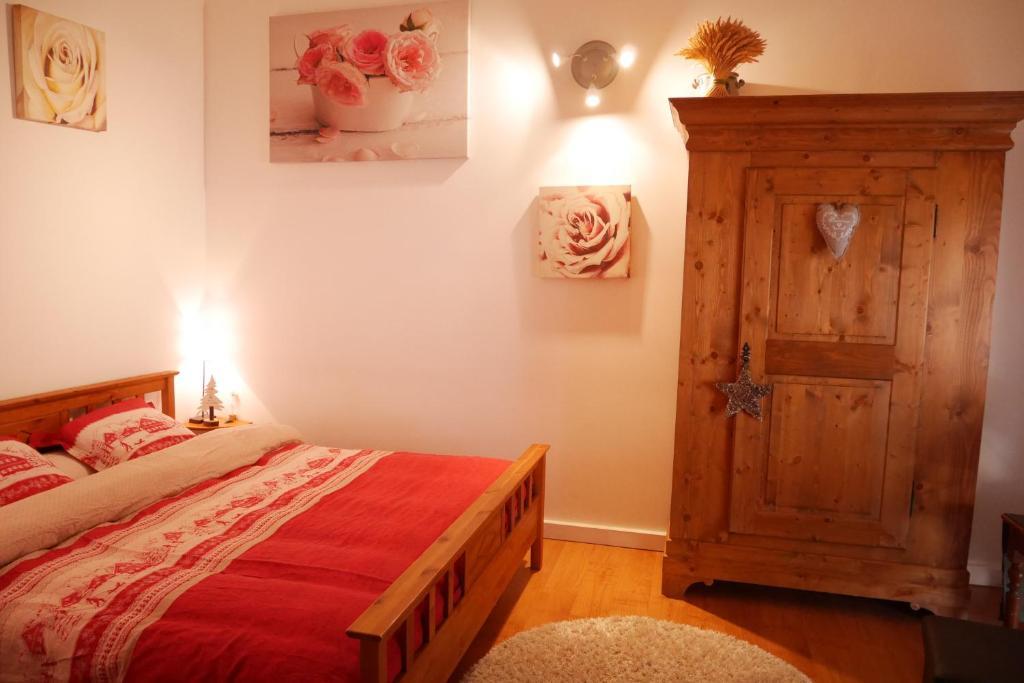 Un ou plusieurs lits dans un hébergement de l'établissement Chambres d'hôtes chez Loulou et Caramel
