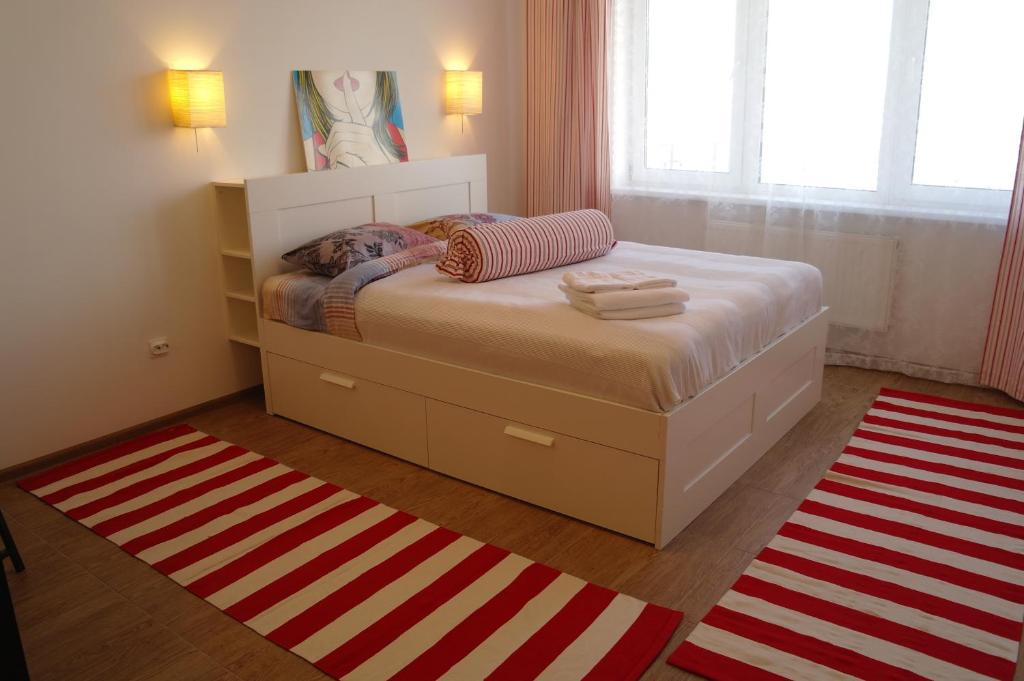 Кровать или кровати в номере ApartLux на Декабрьских Событий