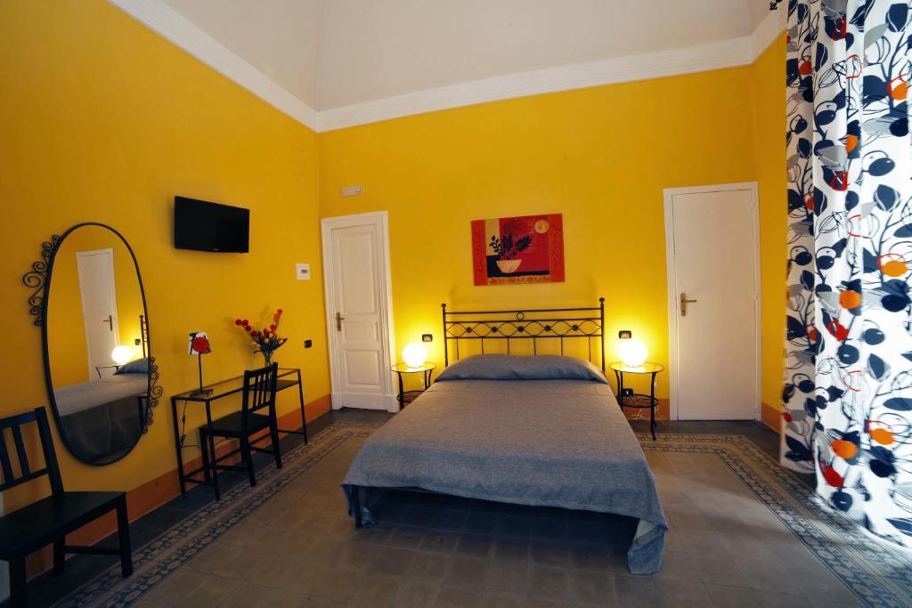 Letto o letti in una camera di B&B Nel Cuore di Catania