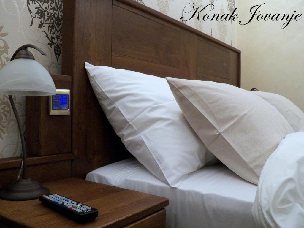 A bed or beds in a room at Konak Jovanje