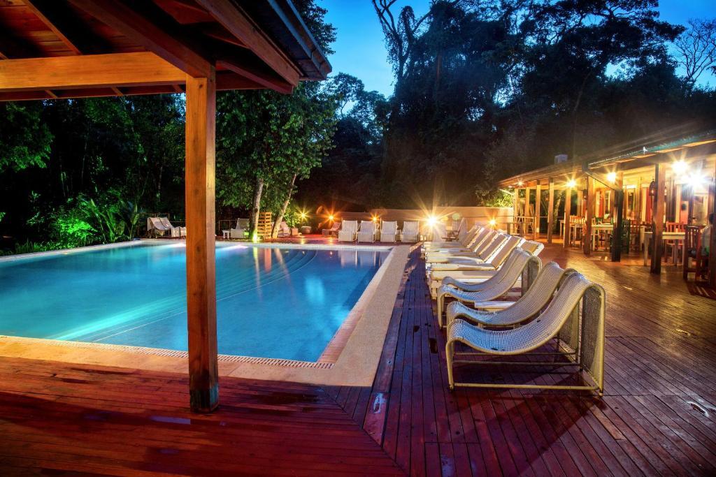 The swimming pool at or near La Cantera Lodge de Selva by DON
