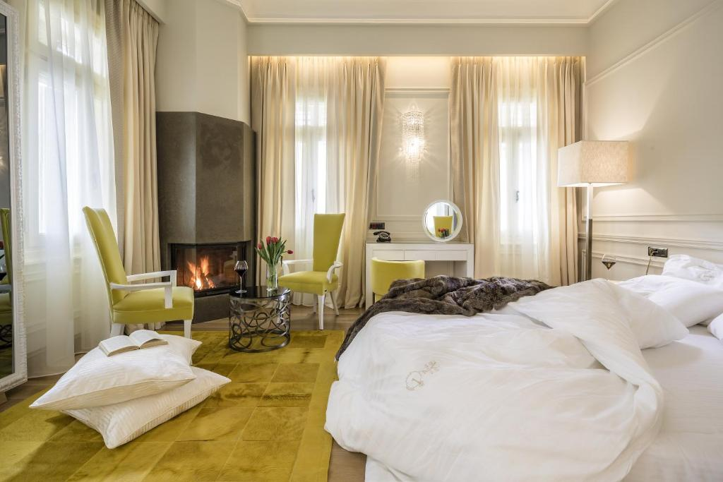 Łóżko lub łóżka w pokoju w obiekcie 3 Sixty Hotel & Suites