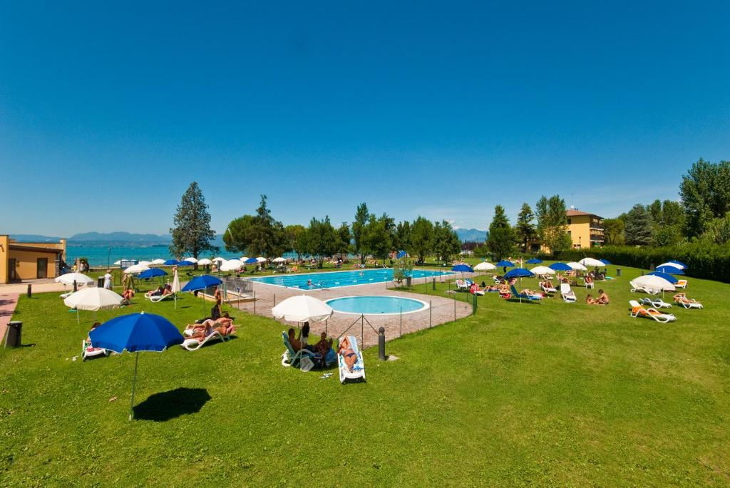 A view of the pool at Campeggio del Garda or nearby