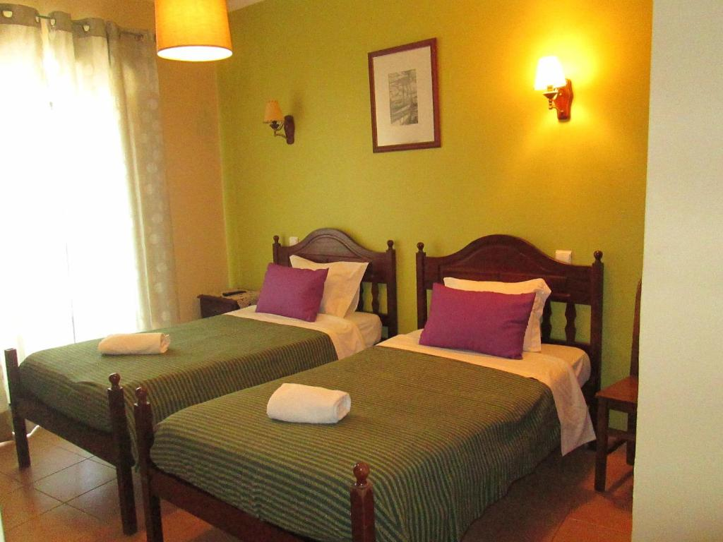 A bed or beds in a room at Guest House Capitao Mor