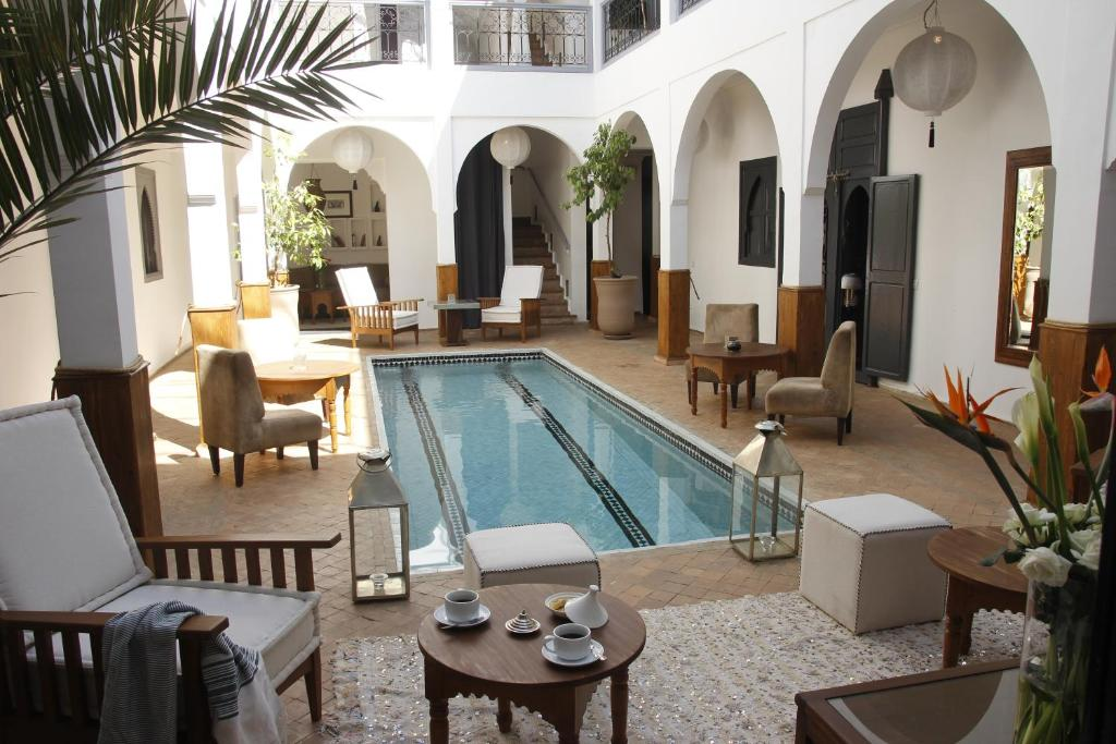 The swimming pool at or near Riad Utopia Suites And Spa