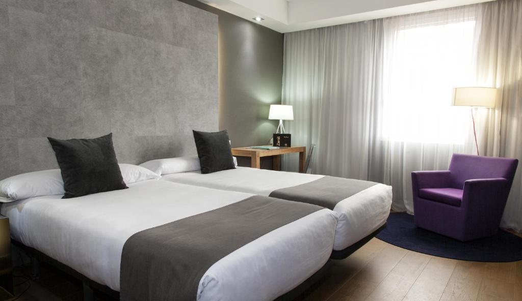A bed or beds in a room at Zenit Conde de Orgaz